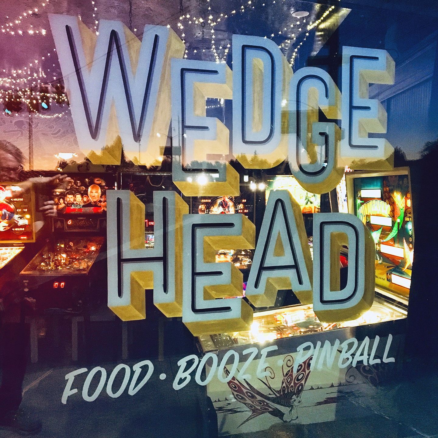 Wedgehead PDX - sunset reflected on the window
